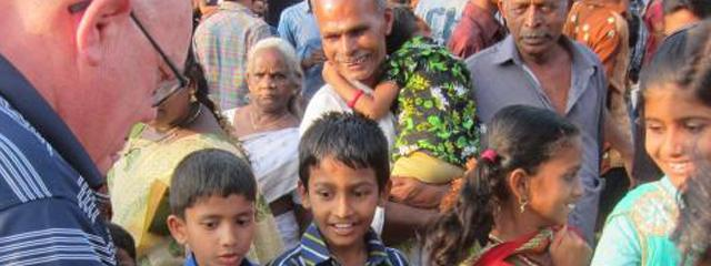 Joe Barth speaks with a group of locals in India