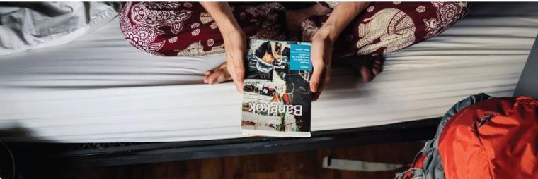 Traveler holding a brochure