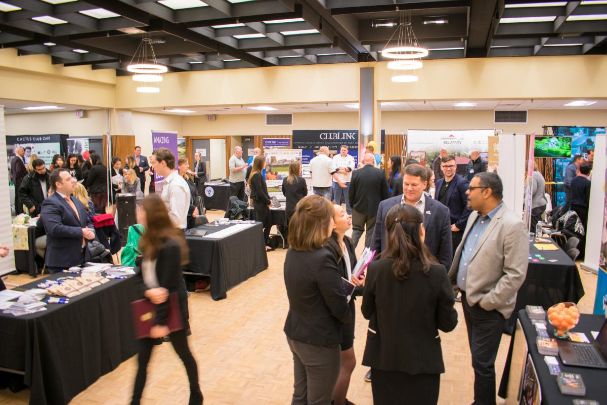 Photo of employers and students at the Job Expo