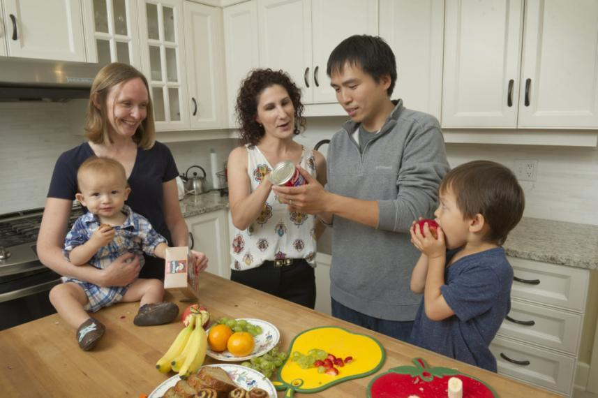 A photograph of a family examining nutritious food