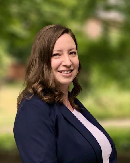 A photograph of Dr. Jennifer Monk.