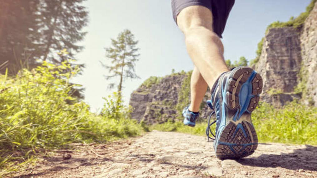 A photograph of a man jogging