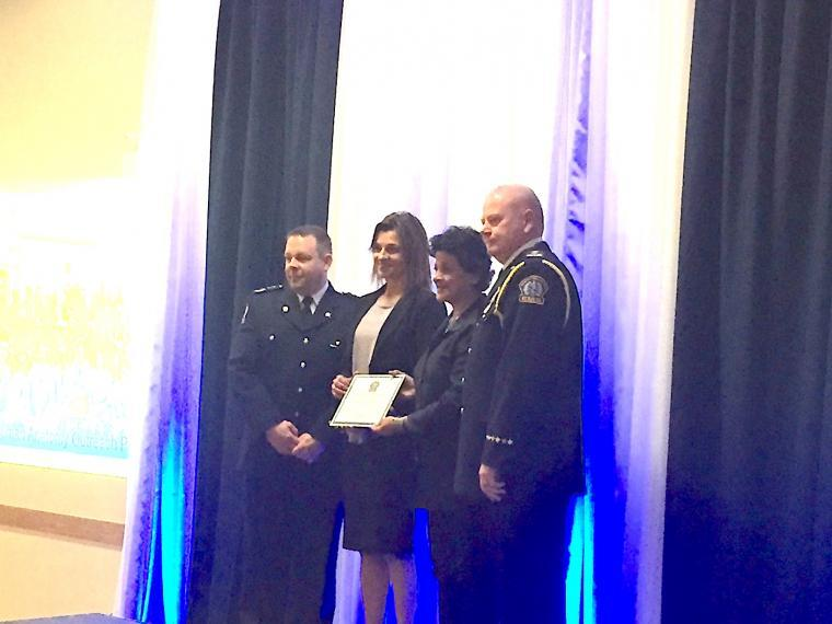 A photograph of Dr. Lorraine Jadeski and Premila Sathasivam being presented with a plaque by paramedics