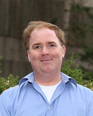 A photograph of Dr. Jeremy Simpson.