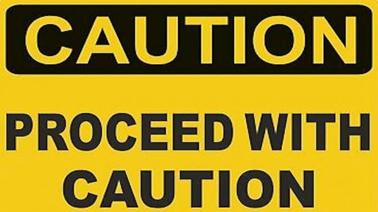 "Warning Sign stating ""Caution. Proceed with Caution"""