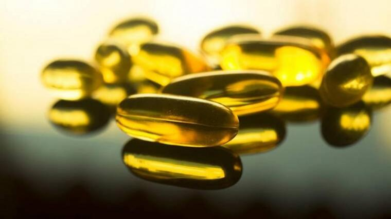A photograph of a fish oil supplement capsules.