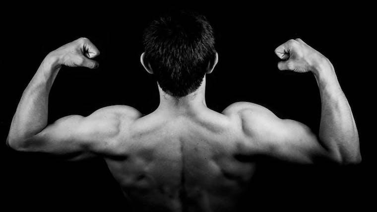 A photograph of a man flexing his muscles