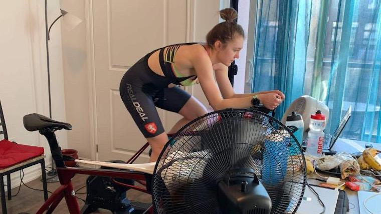 A photograph of Heather Petrick on her exercise bicycle.