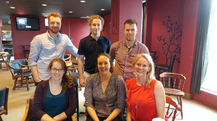 A photograph of the SOMBS organizing team consisting of (back row: Keaton Inkol, Jake Chaput, Lukas Linde. Front Row: Emily McIntosh, Becky Breau, Lori Vallis). Missing is David Shulman