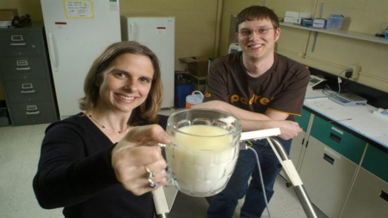 A Photograph of Dr. Lindsay Robinson holding a mug with a student behind the scenes in the Human Nutraceutical Research Unit