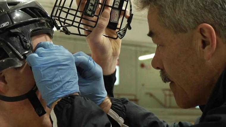 Dr. Lawrence Spriet with a hockey player