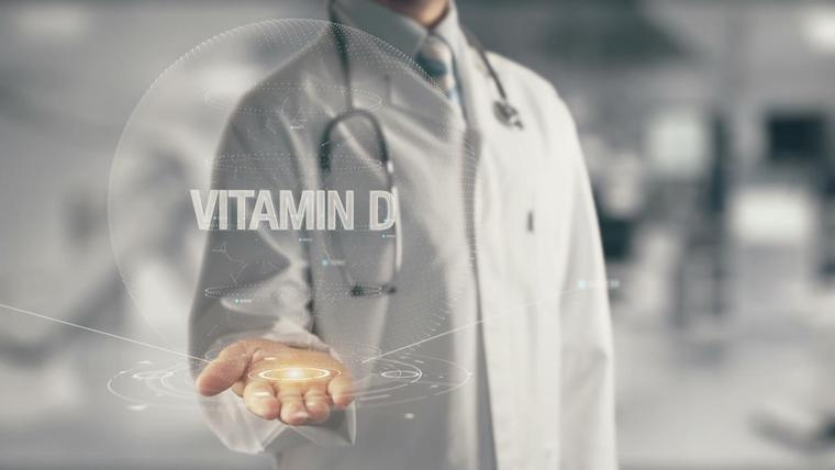 An image of a scientist in a lab-coat with the title Vitamin D