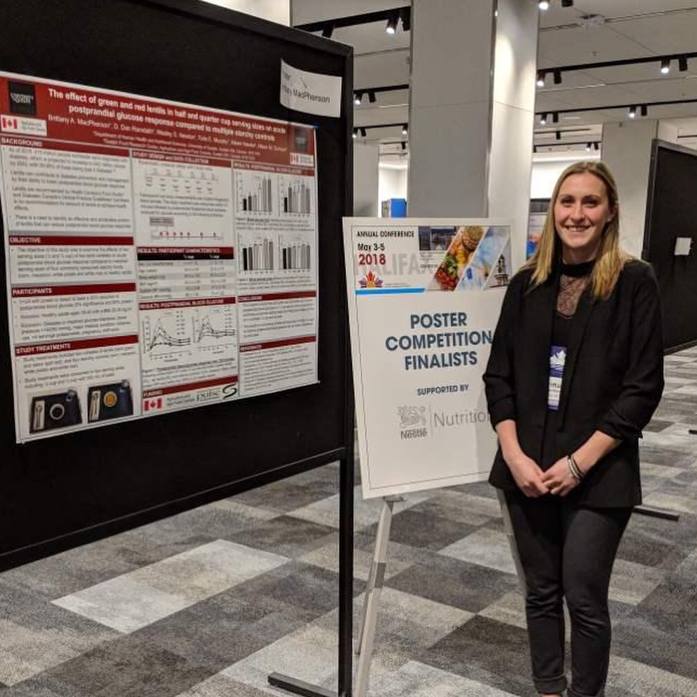 A photograph of Brittany MacPherson and her award winning Poster