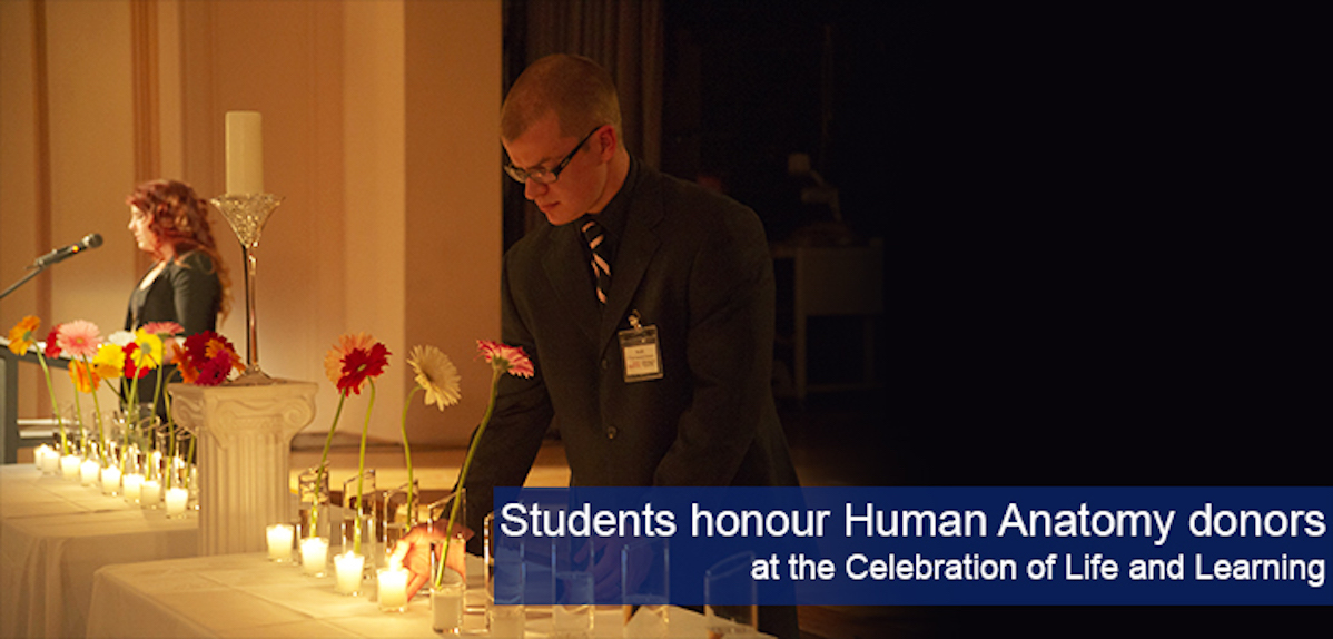A photograph of undergraduate students lighting candles at the Celebration of Life ceremony.