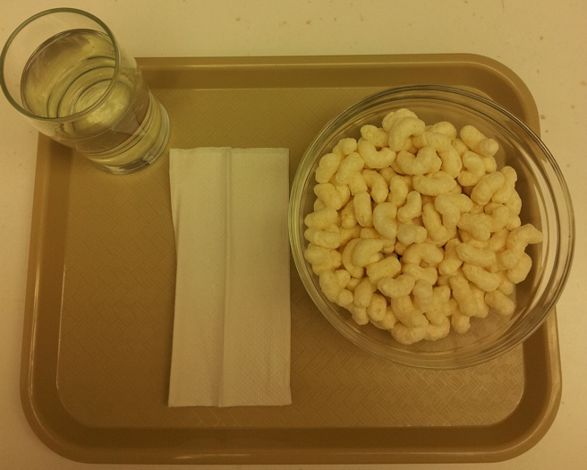 Serving of millet extruded snack in bowl to be served to participants.