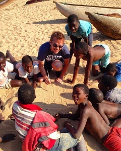 This is a picture of Daniel Gillis, U of G Assistant Professor and Statistician in the School of Computer Science on Leave for Change in 2017 as Database Management Advisor with the Agricultural Research and Extension Trust (ARET) in Malawi. He is pictured here teaching math to children on a beach.