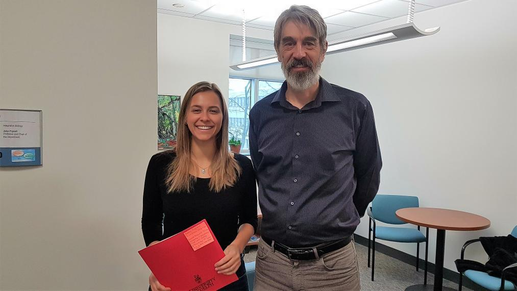 Photo of Bailey Bingham and Dr. John Fryxell, Chair, Integrative Biology