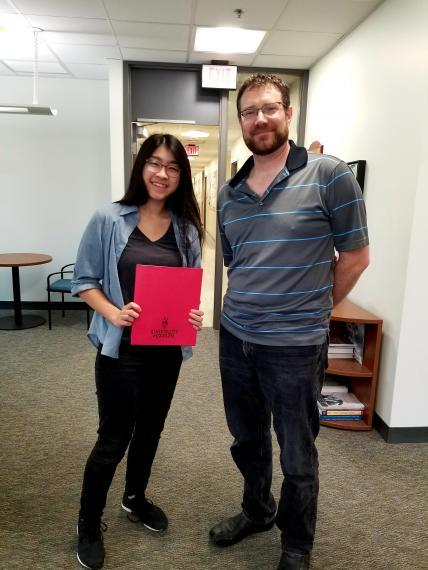 Photo of Hagen Award recipient Elisa Lau and the Chair of Integrative Biology, Ryan Gregory