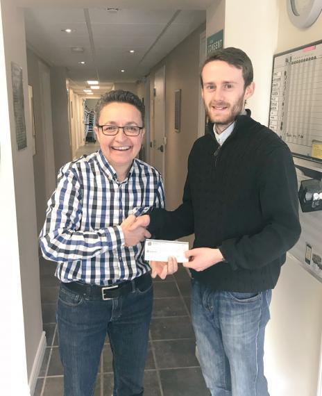 Chris Greyson-Gaito presents cheque to Guelph-Wellington Women in Crisis Executive Director, Sly Castaldi