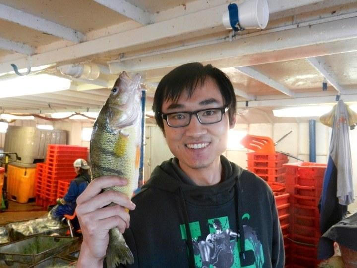 Dr. Fan Zhang holding yellow perch