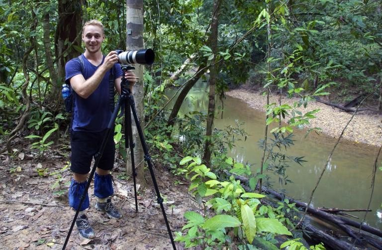 David Borish with camera in jungle