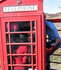 Photo of students in a phone booth