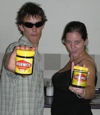 Two students holding jars of Vegemite