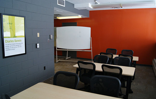 Space offers multiple tables, chairs, whiteboards