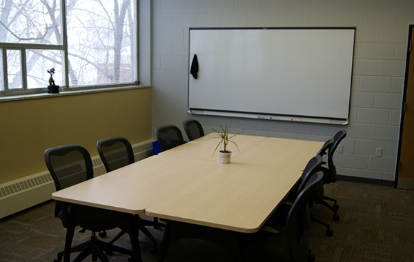 Open work spaces features boardroom table and whiteboard