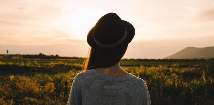Silhouette of a woman in a field.