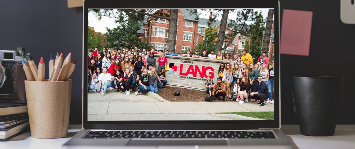 Photo of a laptop with an image of Lang Students on the screen