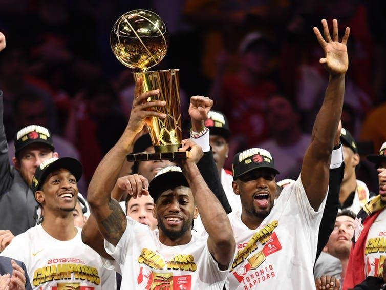 Raptors winning the NBA championship, holding trophy