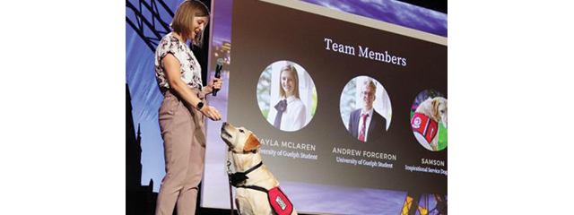 Student with guide dog on stage