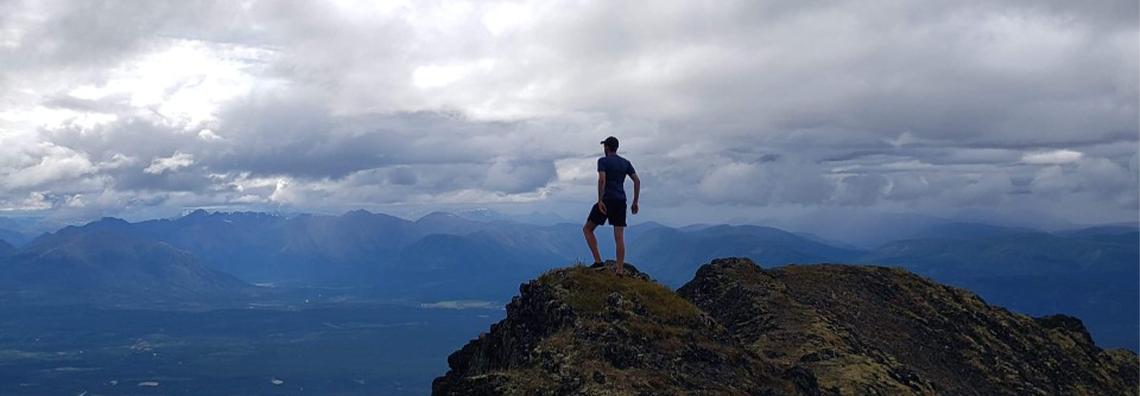 Nathan standing on mountains