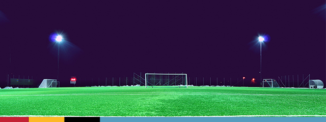 photo of empty soccer field at night
