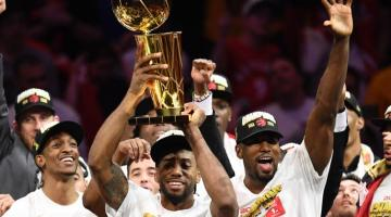 Raptors winning the NBA championship, holding trophy