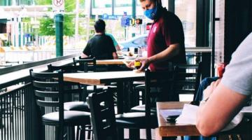 photo of restaurant staff member measuring table distances