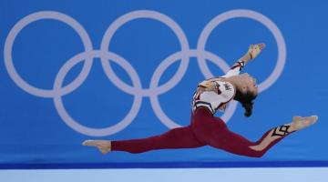 Female gymnast in the air at the Tokyo 2020 Olympic Games