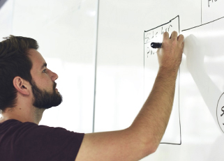 entrepreneur drawing on a whiteboard