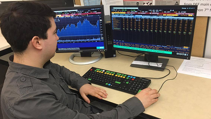 Ryan Martin works on bloomberg terminal