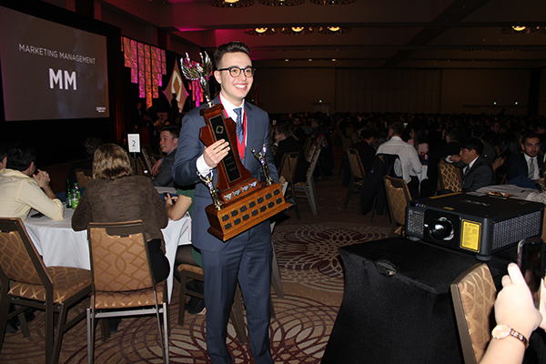 U of G student delegate with trophy