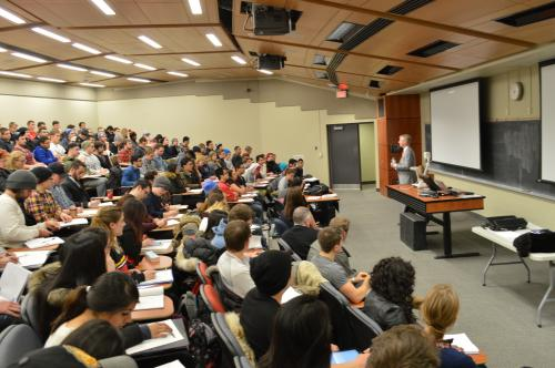 Photo of Ken Miner speaking to Economics students at University of Guelph business school