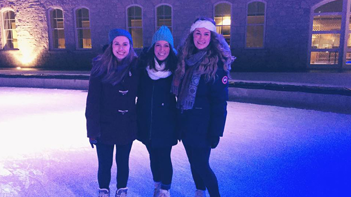 Amy and two friends skate at the downtown rink