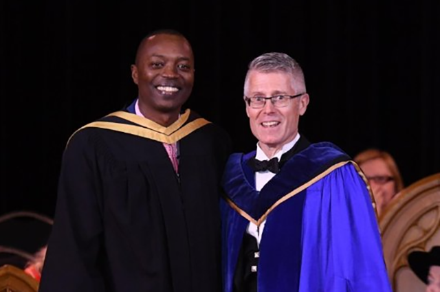 Amani Hitimana (L) with Malcolm Campbell, VP of Research at the University of Guelph (R)