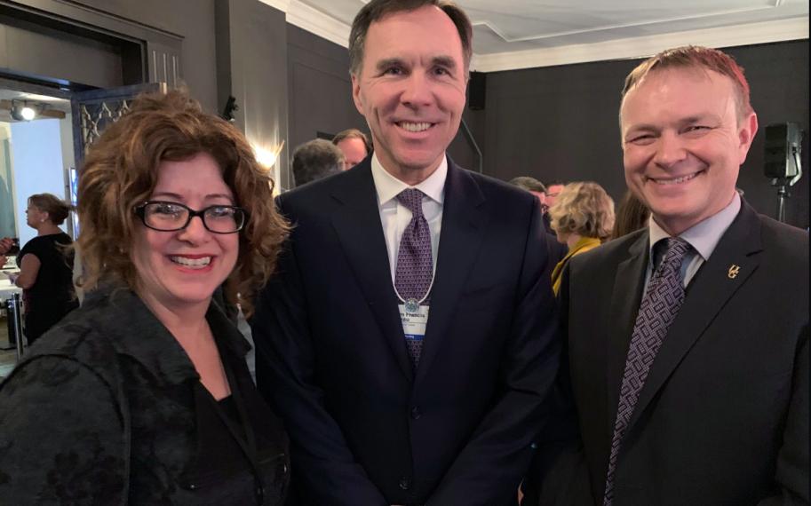 Dean Julia Christensen Hughes with Bill Morneau and Evan Fraser in Davos.