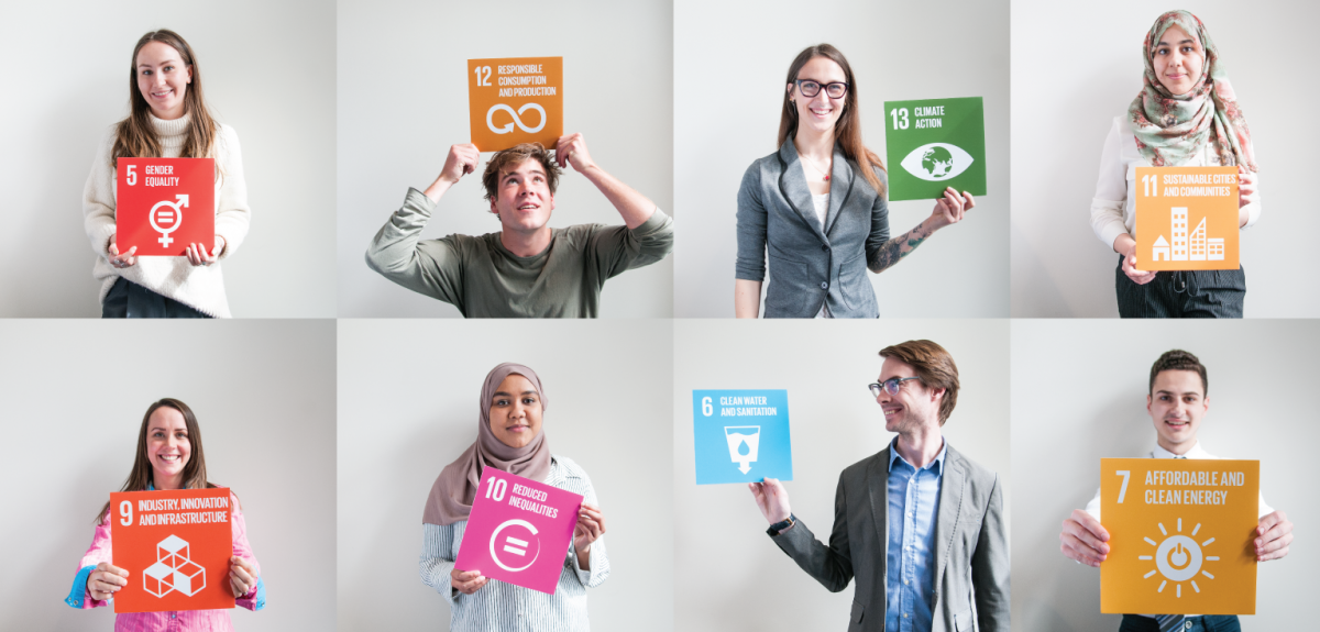 students holding sustainable development goals