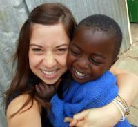 Photo of Amy Faria volunteering in Africa