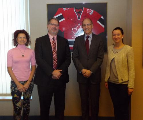 Photo of Brent McKenzie with Ambassador Morrison and two staff