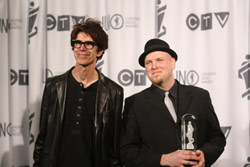 Stretch Orchestra members Matt Brubeck and Jesse Stewart (right) accept their Juno Award