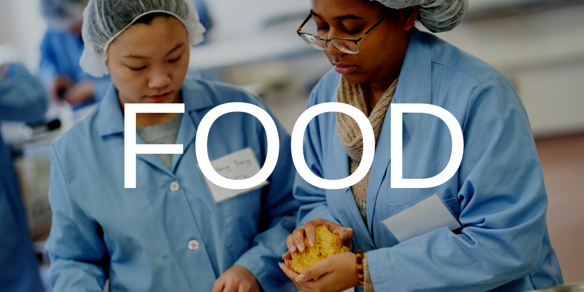 Two students in a food science lab, with the text Food overlaid.